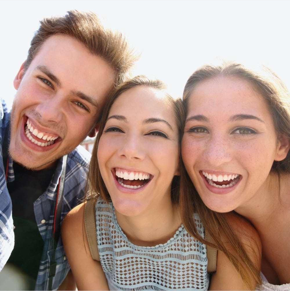 group of young adults smiling and laughing